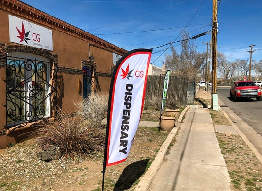 In this Wednesday, March 6, 2019 photo, the exterior of a medical marijuana dispensary is seen in Santa Fe, N.M.