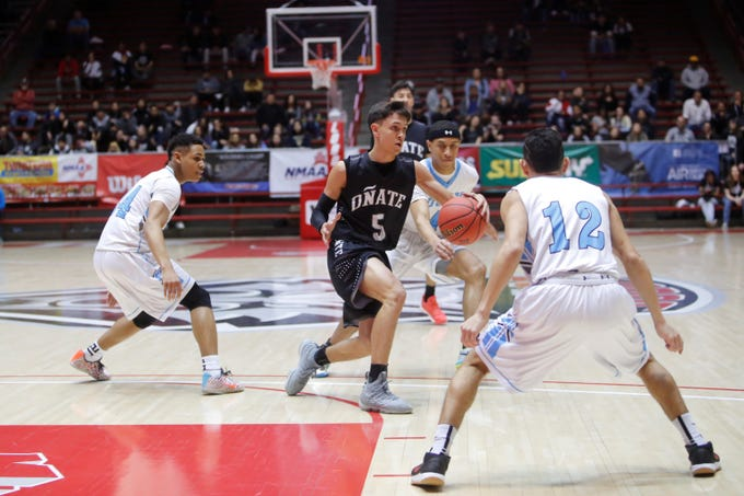 Oñate's Ricky Lujan crosses to the left against Cleveland during Wednesday's 5A state quarterfinals at Dreamstyle Arena in Albuquerque.