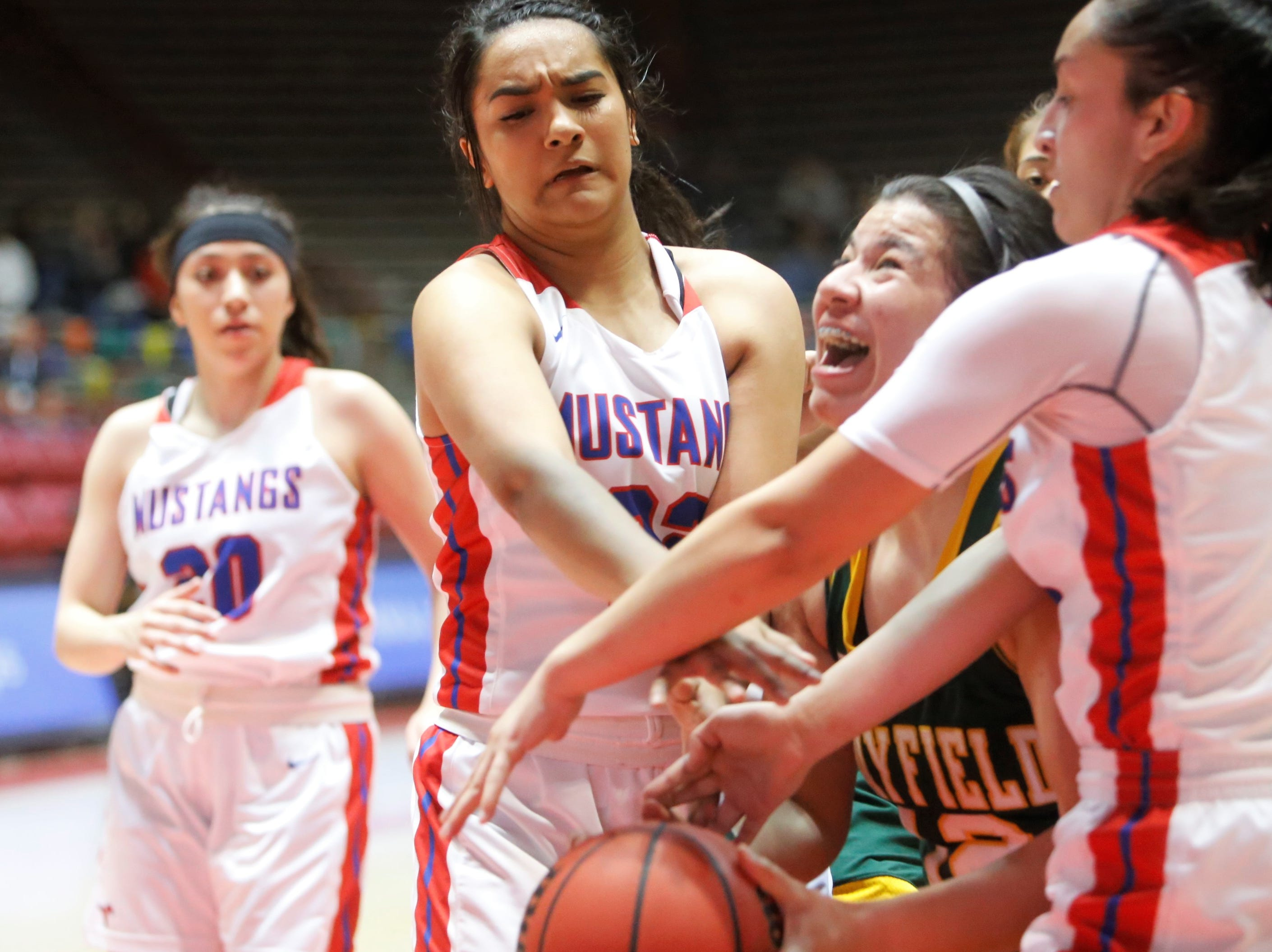 Mayfield's Alize Ruiz gets fouled by West Mesa's Cece Barela (22) during Tuesday's 5A state quarterfinals game at Dreamstyle Arena in Albuquerque.
