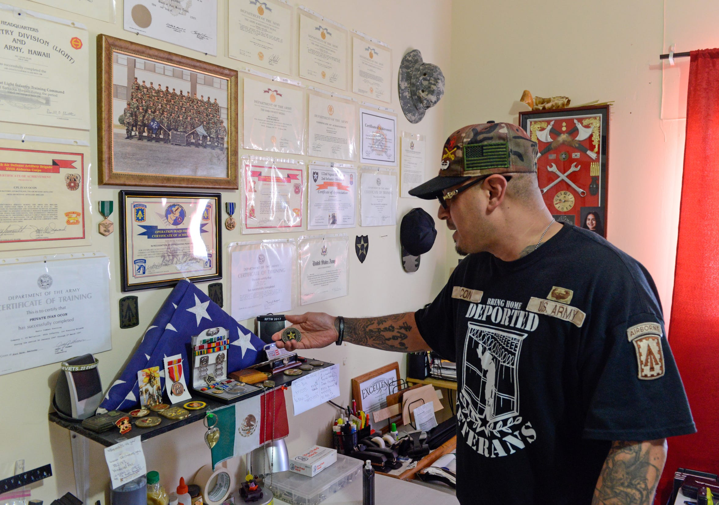 Ivan Ocon shows off some of the honors he received during his seven years in the U.S. Army.