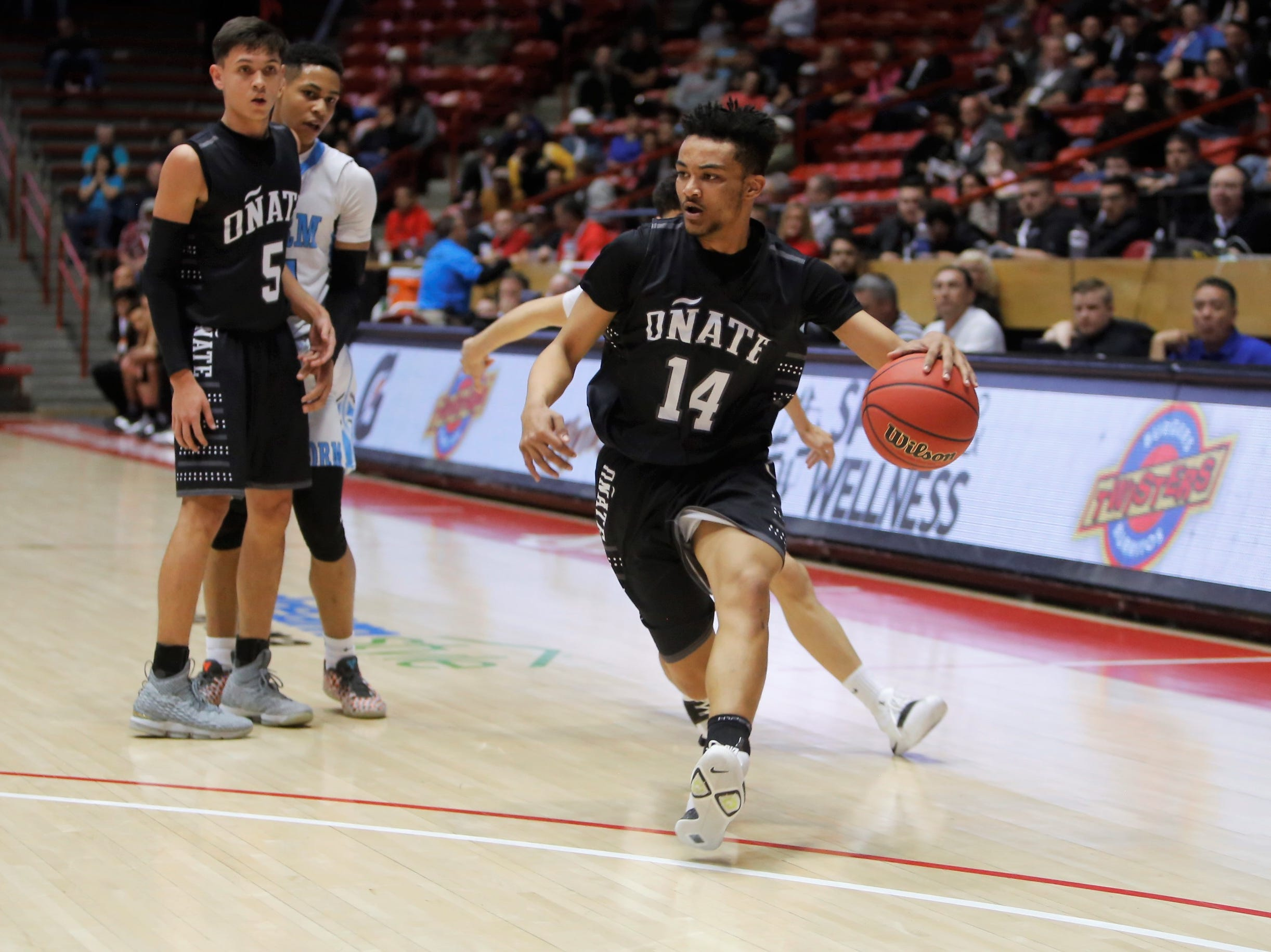 Oñate's Joshua Phillips drives in from the top left edge of the wing against Cleveland during Wednesday's 5A state quarterfinals at Dreamstyle Arena in Albuquerque.