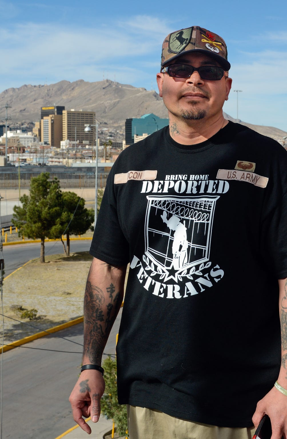 Ivan Ocon in Juárez, where he has lived since being deported from the United States in 2016, with the skyline of El Paso in the background. He longs to return to the United States.