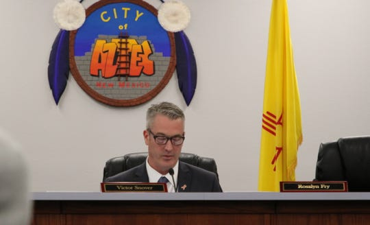Aztec Mayor Victor Snover calls the name of a person wanting to comment Tuesday during an Aztec City Commission meeting.