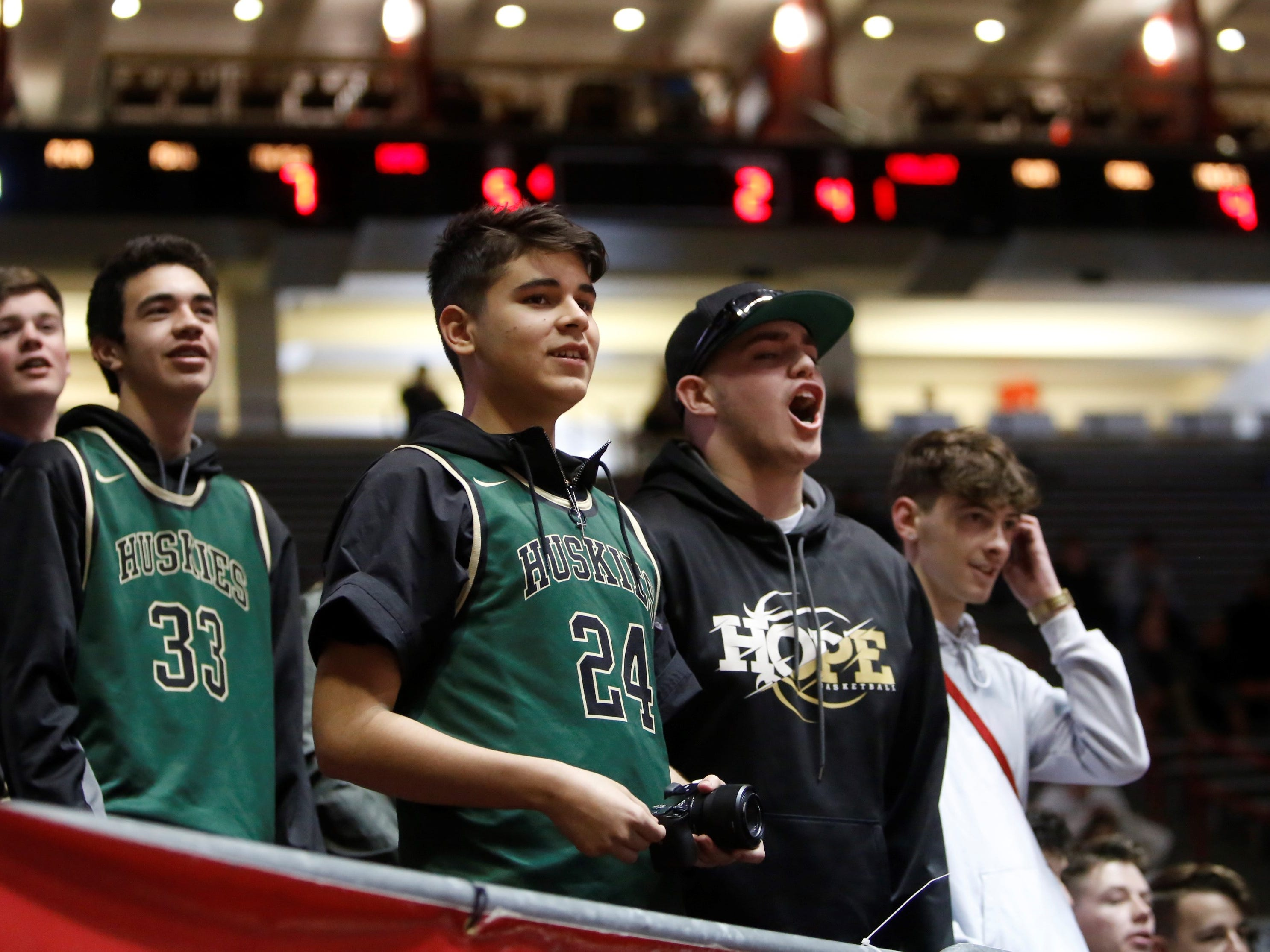 Hope Christian fans start getting loud during a Valley free throw attempt during Wednesday's 4A state quarterfinals at Dreamstyle Arena in Albuquerque.