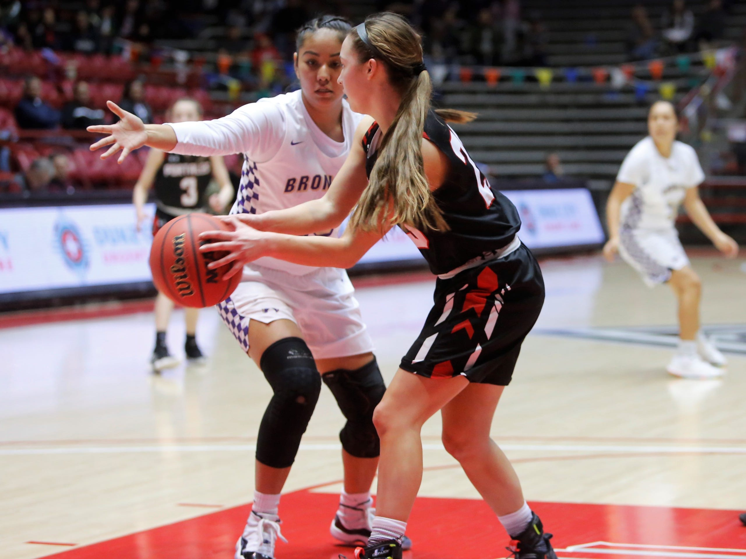 Portales's Mattison Blakey looks to make a bounce pass against Kirtland Central's Aubrey Thomas during Tuesday's 4A state quarterfinals game at Dreamstyle Arena in Albuquerque.