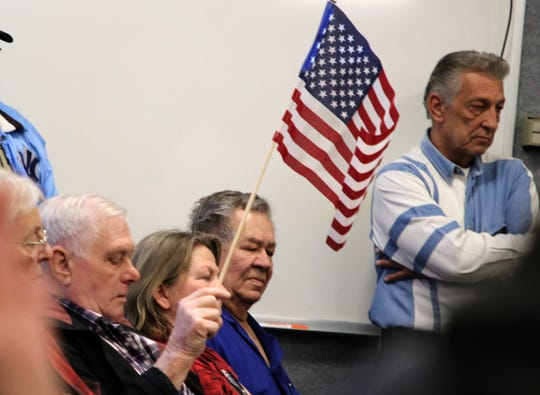 People brought American flags to the Aztec City Commission meeting Tuesday to show their support for the Second Amendment and their opposition to gun control measures.