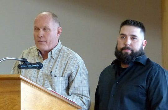 Dave Anderson, left, and Josh McCurdy  went over the benefits to the village of recreational marijuana.
