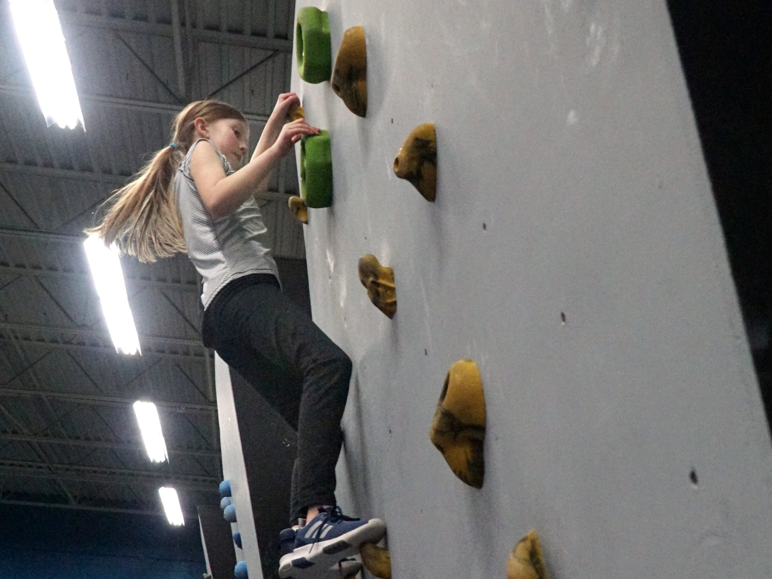 Fallon Stover, 9, ascends a climbing wall at Plymouth's The Edge Training Center on March 13, 2019. Stover and a group of youngsters were there that night to continue training on an obstacle-strength course inside the Plymouth businesses' gym.