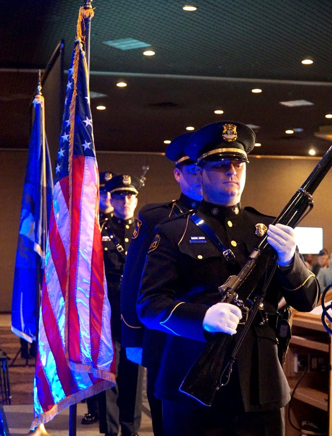 A Livonia Police Department Color Guard, led by officer Dan Sullivan, right, was part of the beginning of Livonia's State of the City gathering on March 13.
