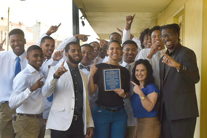 Coach Apphia Jordan and the North Central High School state basketball champions celebrate their victory at Tuesday's Opelousas Board of Aldermen meeting.