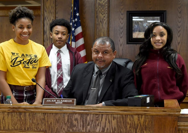 Opelousas Mayor Julius Alsandor celebrates National Beta Club Month with club members from J.S. Clark Leadership Academy. From left are Zyon Lewis, president; JaQuailyn Payane, vice-president; and Ja'Liyah Griffin, secretary. The club is sponsored by JoAnna Augustine.