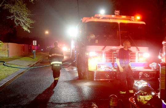 Firefighters at an early morning fire Sunday on Jake Drive in Opelousas.