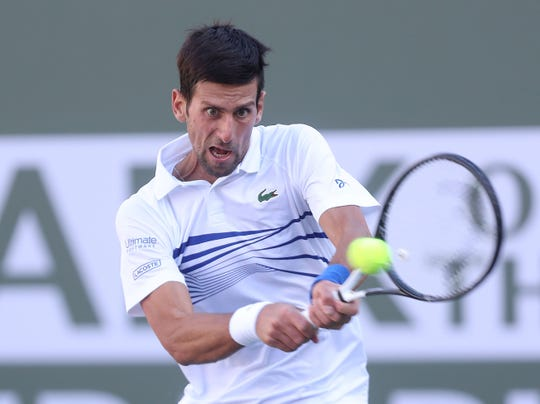 Novak Djokovic hits a shot during his loss to Philip Kohlschreiber at the BNP Paribas Open, March 12, 2019.