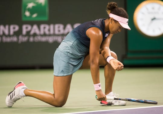 Defending women's champion Naomi Osaka reacts to her bad play against Belinda Bencic on Stadium 2 at the 2019 BNP Paribas Open at Indian Wells Tennis Garden on March 12, 2019. Bencic won 6-3, 6-3.