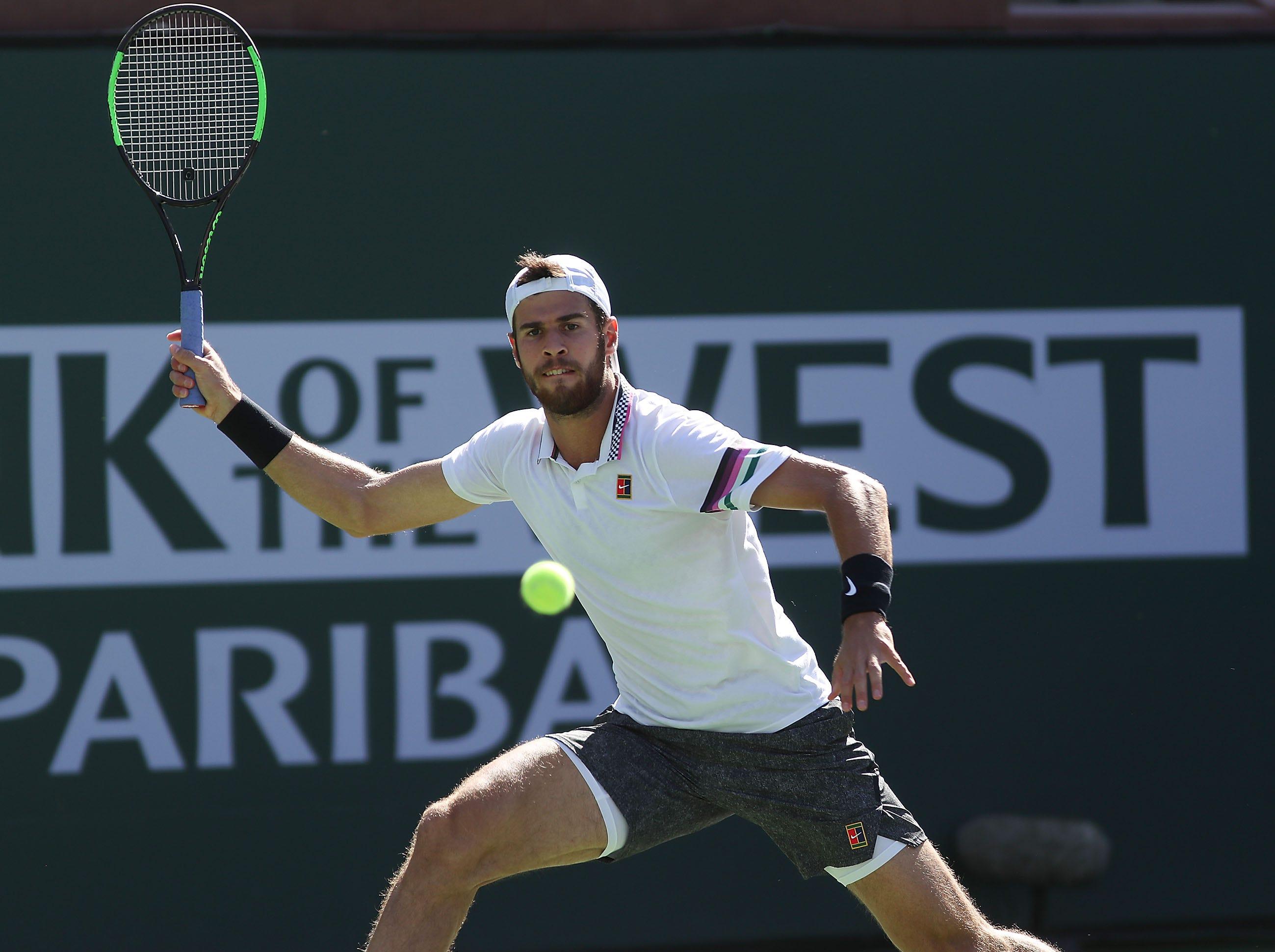 Karen Khachanov hits a shot during his win over John Isner at the BNP Paribas Open in Indian Wells, March 13, 2019.
