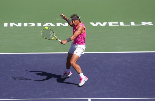 Rafael Nadal hits a lob during his win over Filip Krajinovic during the BNP Paribas Open in Indian Wells, March 13, 2019.