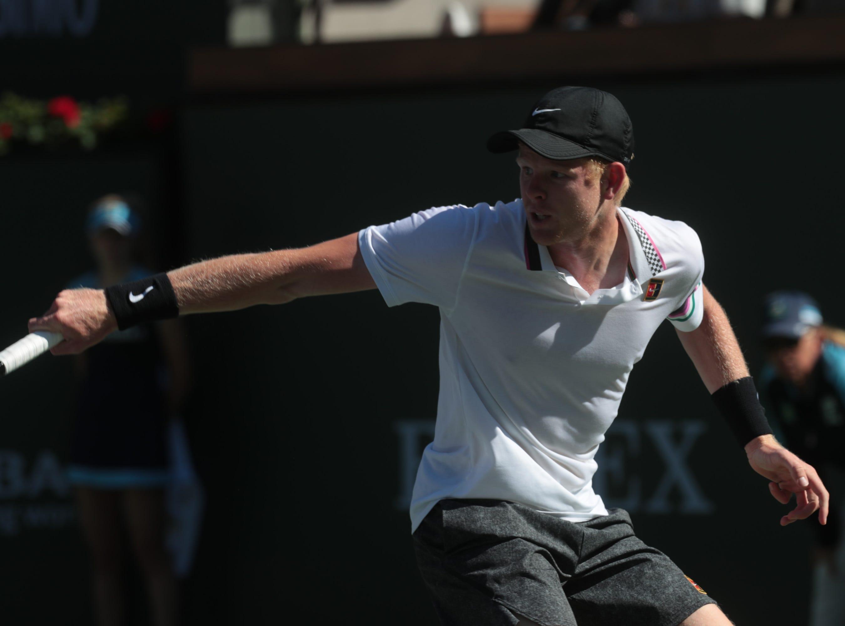 Kyle Edmund returns to Roger Federer at the BNP Paribas Open in Indian Wells, Calif., March 13, 2019.