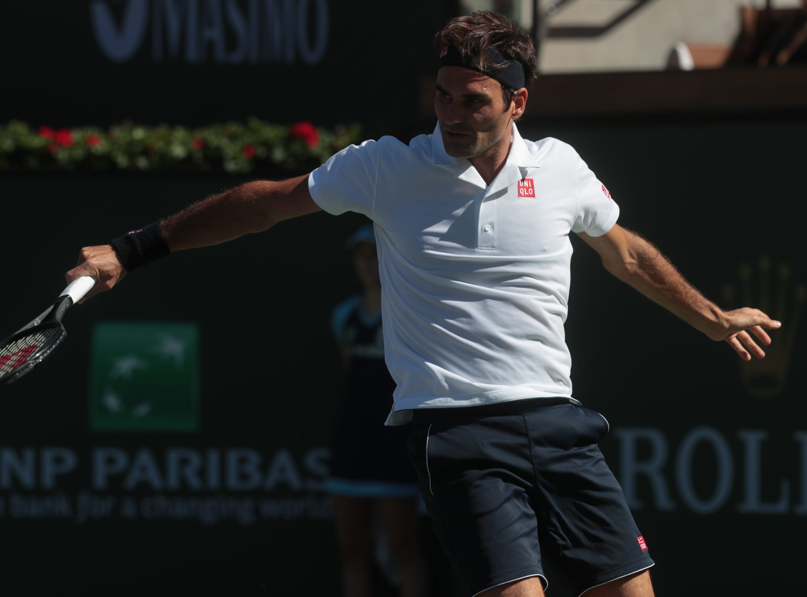 Roger Federer hits a backhand to Kyle Edmund at the BNP Paribas Open in Indian Wells, Calif., March 13, 2019.