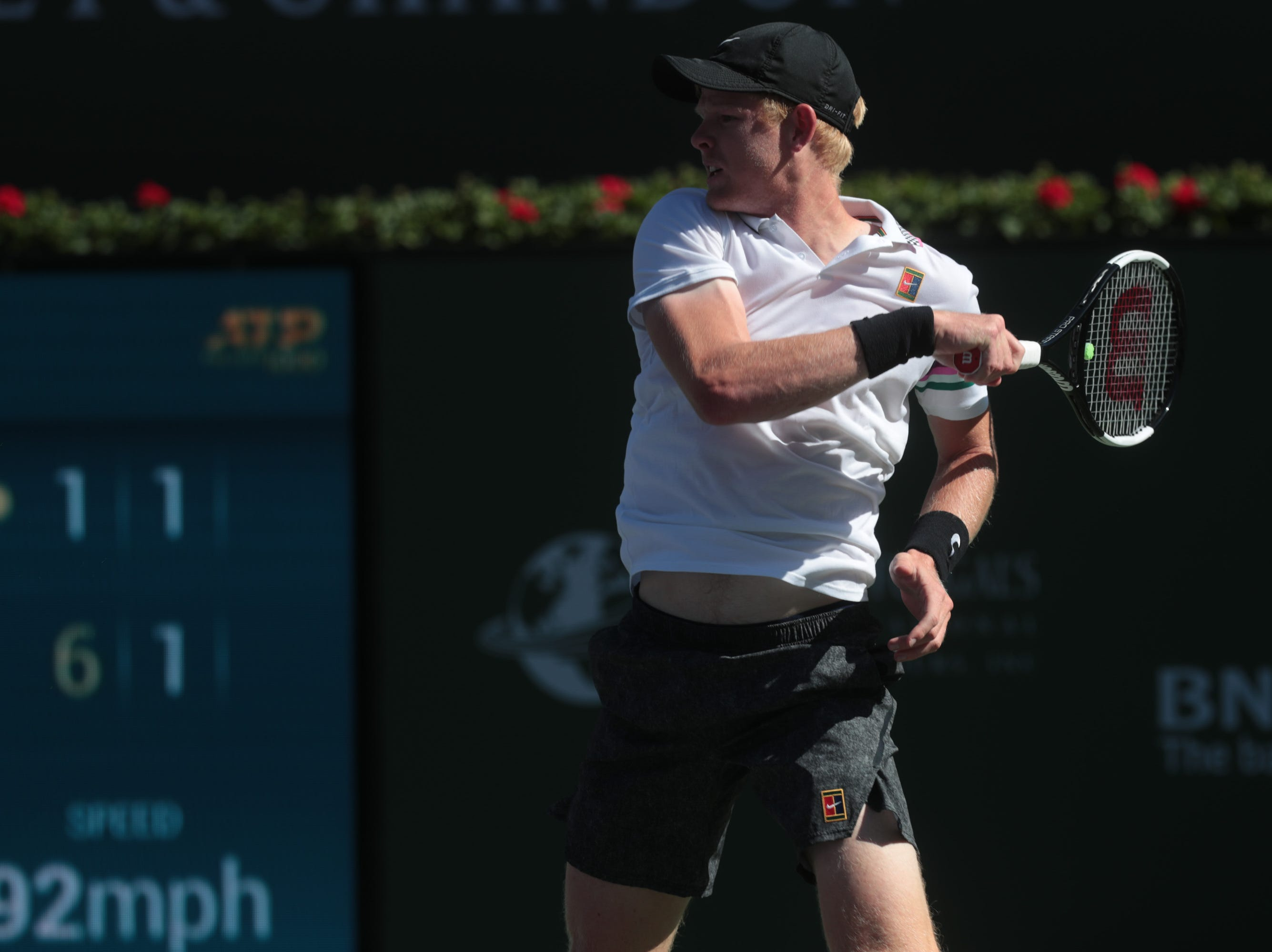 Kyle Edmund hits a baseline shot to Roger Federer at the BNP Paribas Open in Indian Wells, Calif., March 13, 2019.