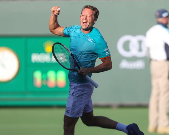 Philipp Kohlschreiber celebrates his victory over Novak Djokovic at the BNP Paribas Open, March 12, 2019.