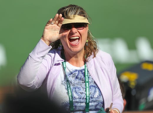 A fan waves to a friend before the start of the Rafael Nadal versus Filip Krajinovic match at the BNP Paribas Open in Indian Wells, March 13, 2019.