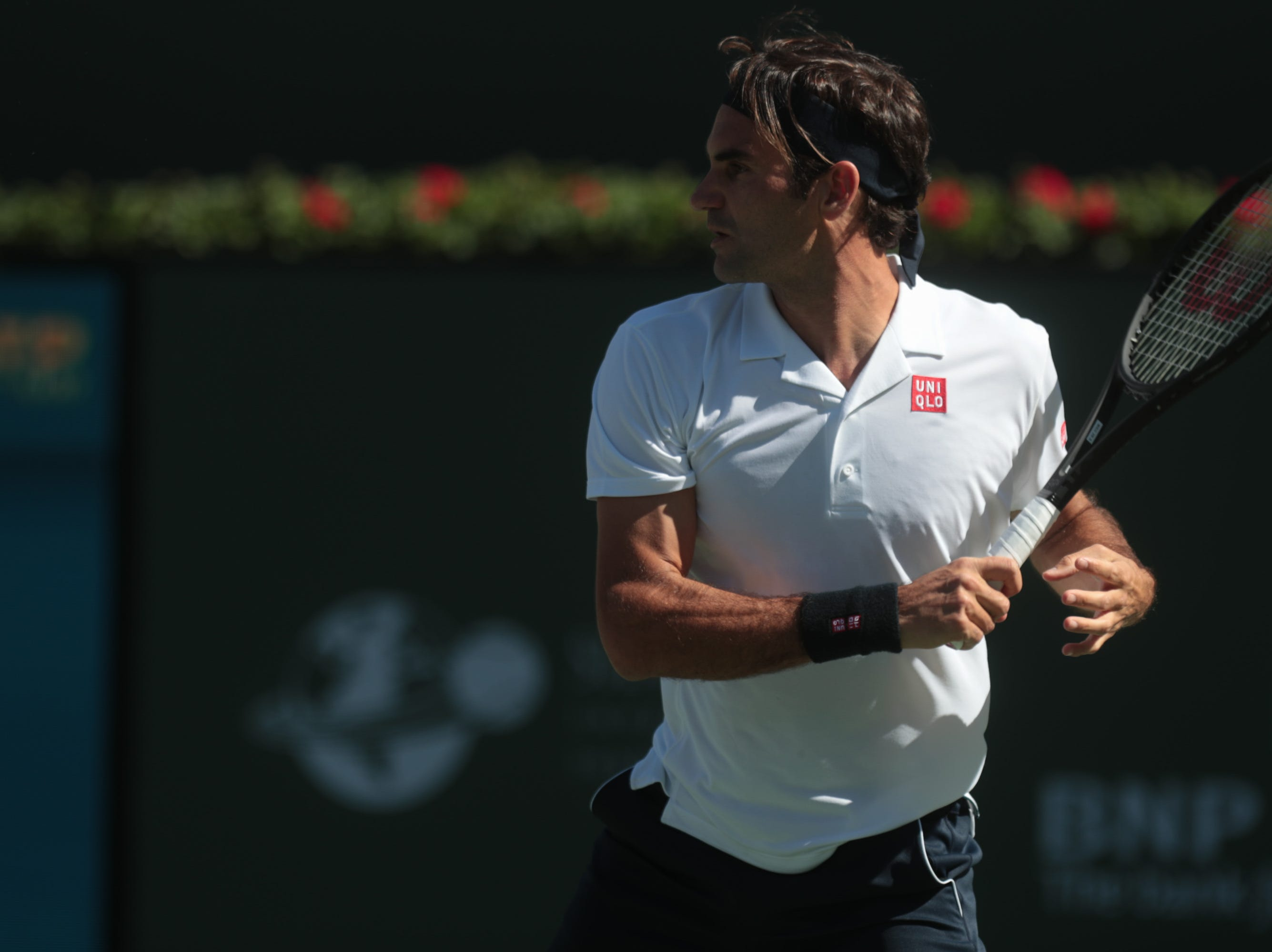 Roger Federer looks towards his shot to Kyle Edmund at the BNP Paribas Open in Indian Wells, Calif., March 13, 2019.
