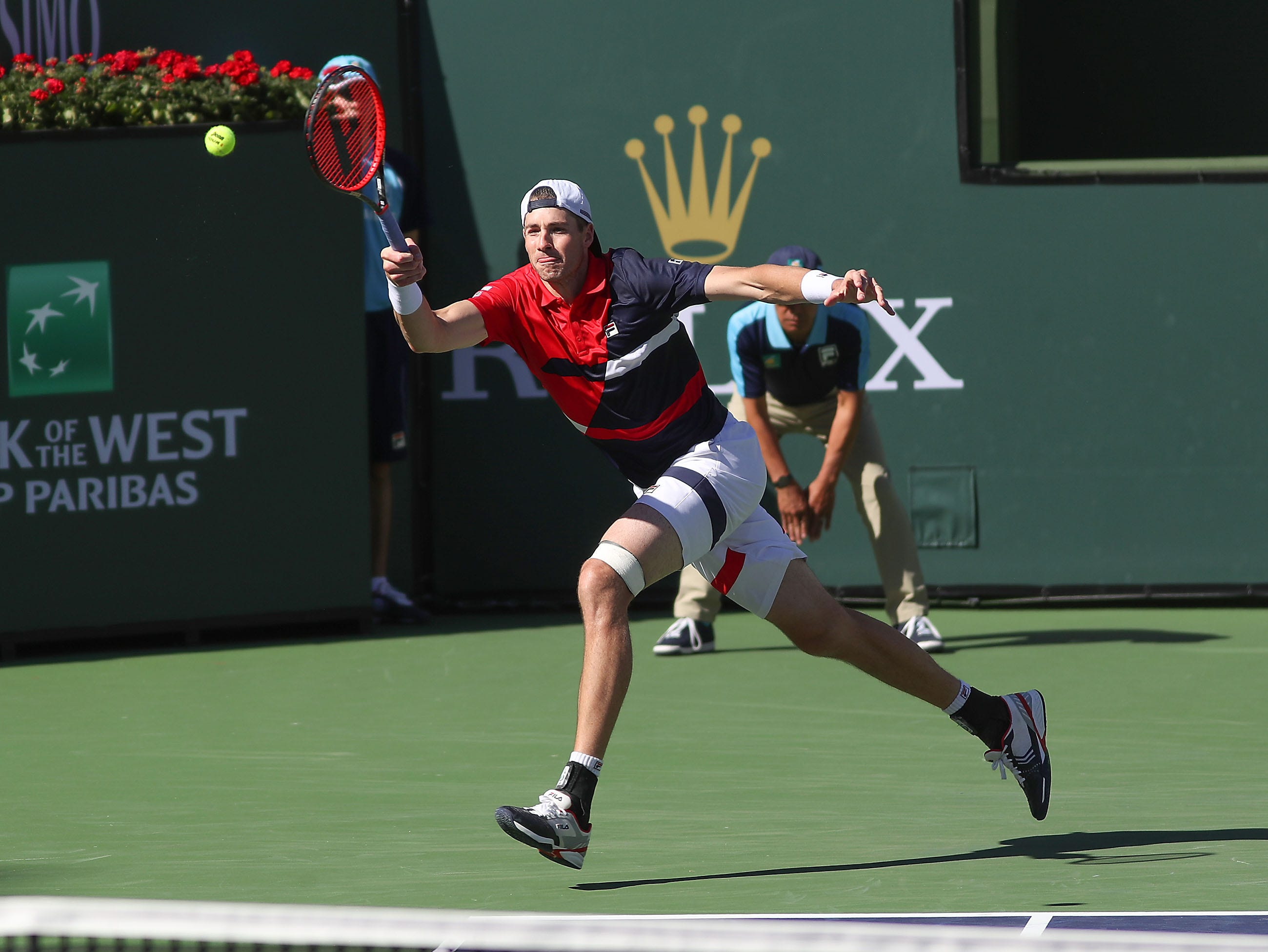 John Isner reaches for a shot during his match against Karen Khachanov during the BNP Paribas Open in Indian Wells, March 13, 2019.
