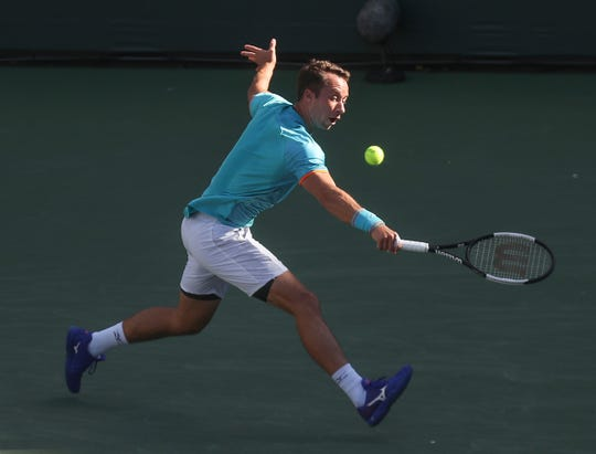 Philip Kohlschreiber hits a backhand during his match against Novak Djokoic at the BNP Paribas Open, March 12, 2019.