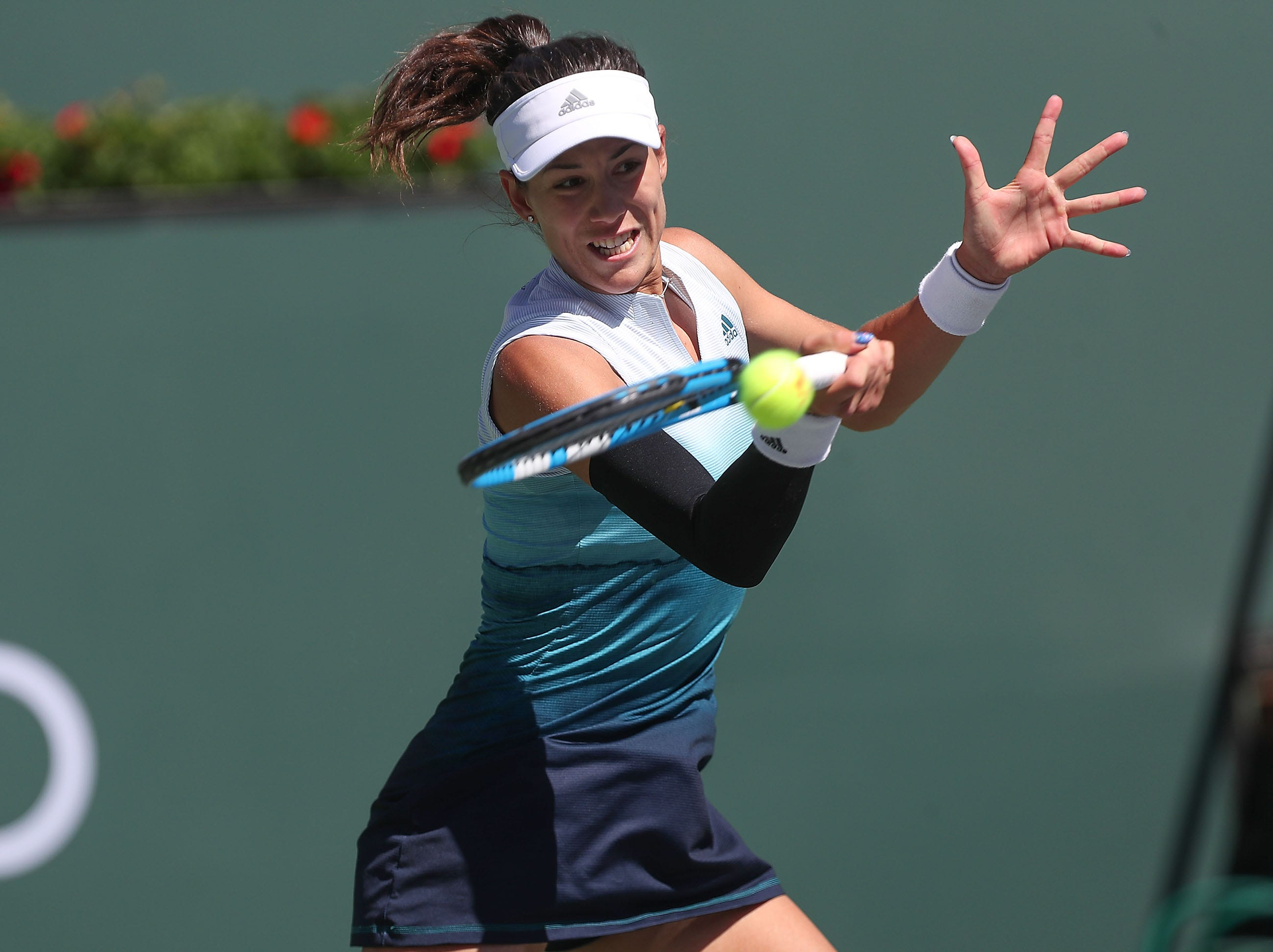 Garbine Muguruza hits a shot during her loss to Bianca Andreescu at the BNP Paribas Open in Indian Wells, March 13, 2019.