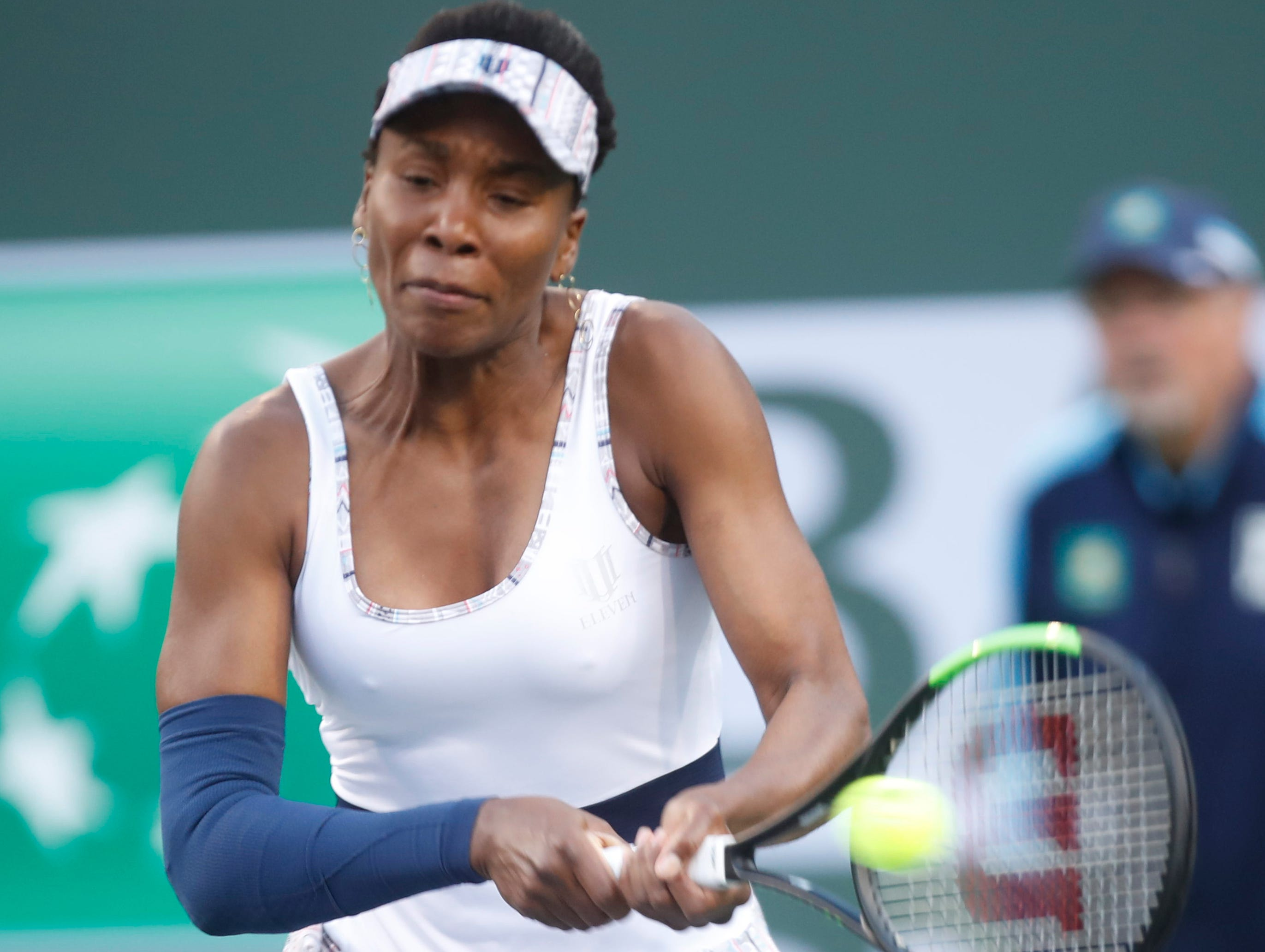 Venus Williams returns a shot to Mona Barthel  on Stadium One at the 2019 BNP Paribas Open at Indian Wells Tennis Garden on March 12, 2019. Williams won the match 6-4, 6-4.