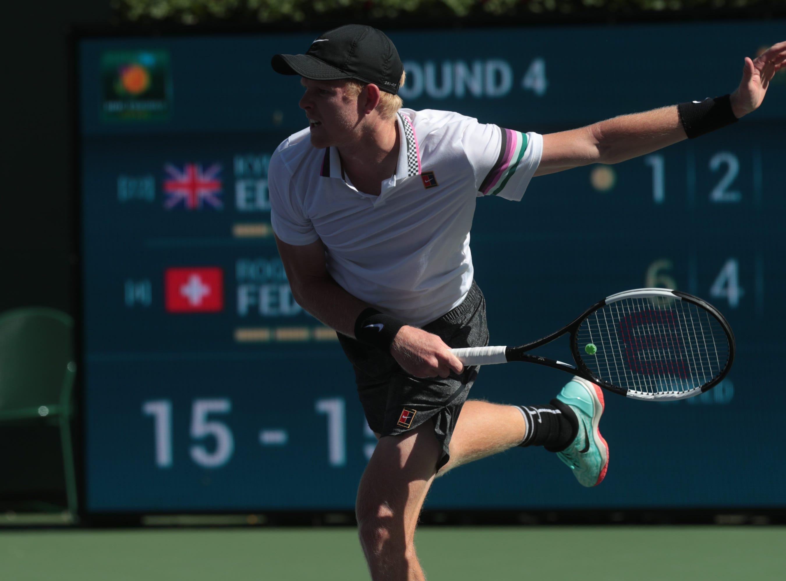 Kyle Edmund serves to Roger Federer at the BNP Paribas Open in Indian Wells, Calif., March 13, 2019.