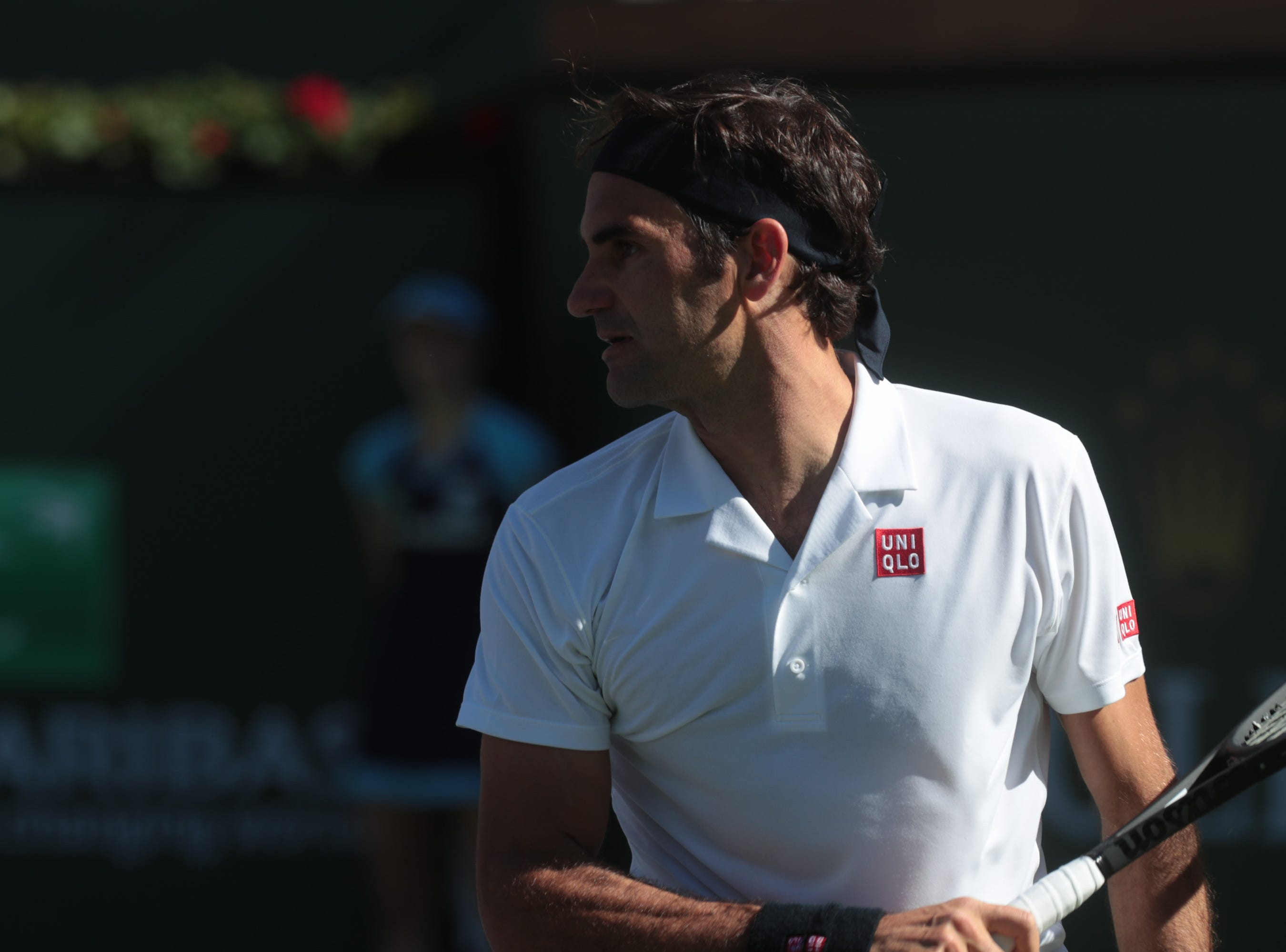Roger Federer looks across the court towards Kyle Edmund in the second set of their match at the BNP Paribas Open in Indian Wells, Calif., March 13, 2019.
