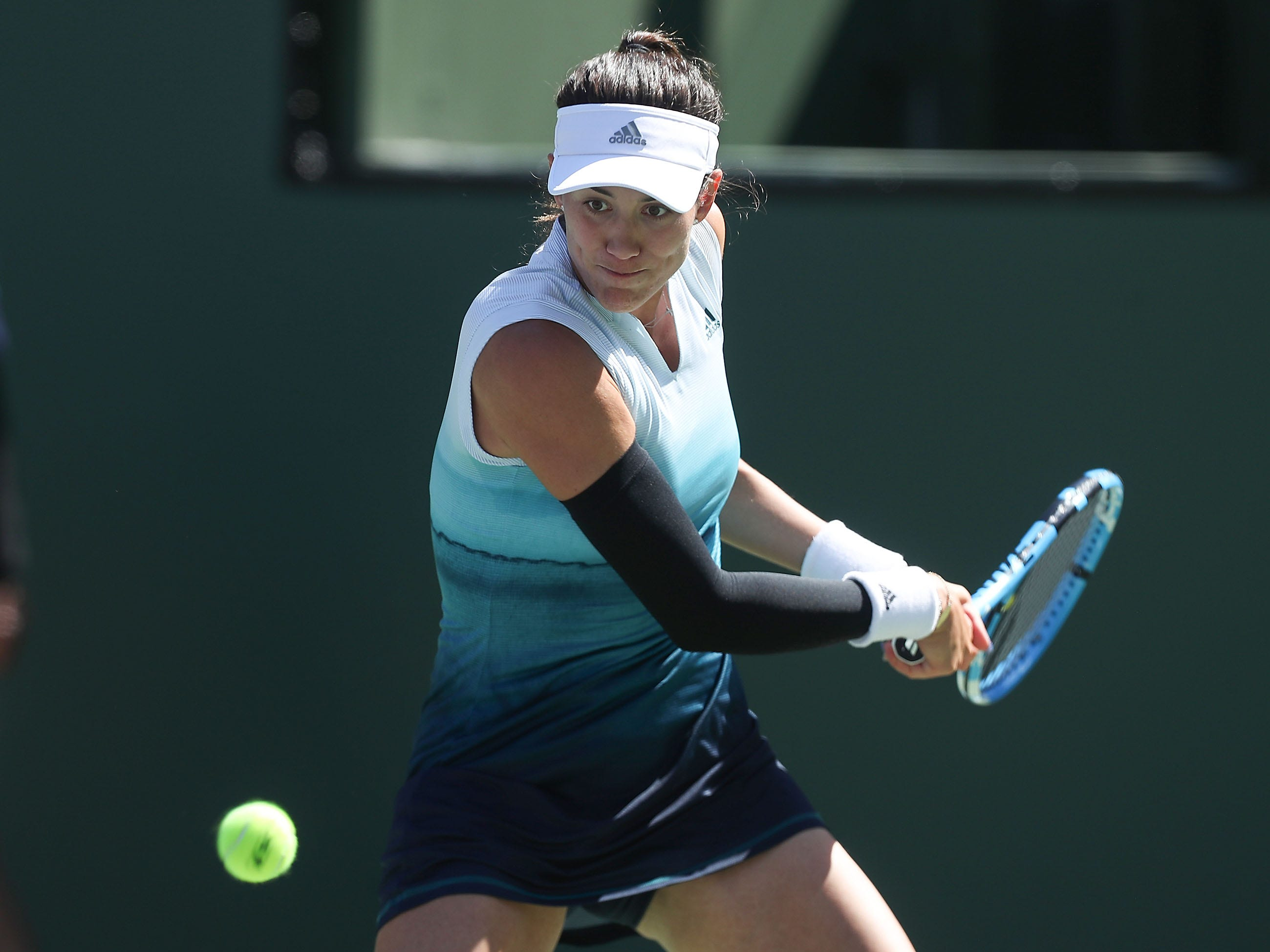 Garbine Muguruza hits a return during her loss to Bianca Andreescu at the BNP Paribas Open in Indian Wells, March 13, 2019.