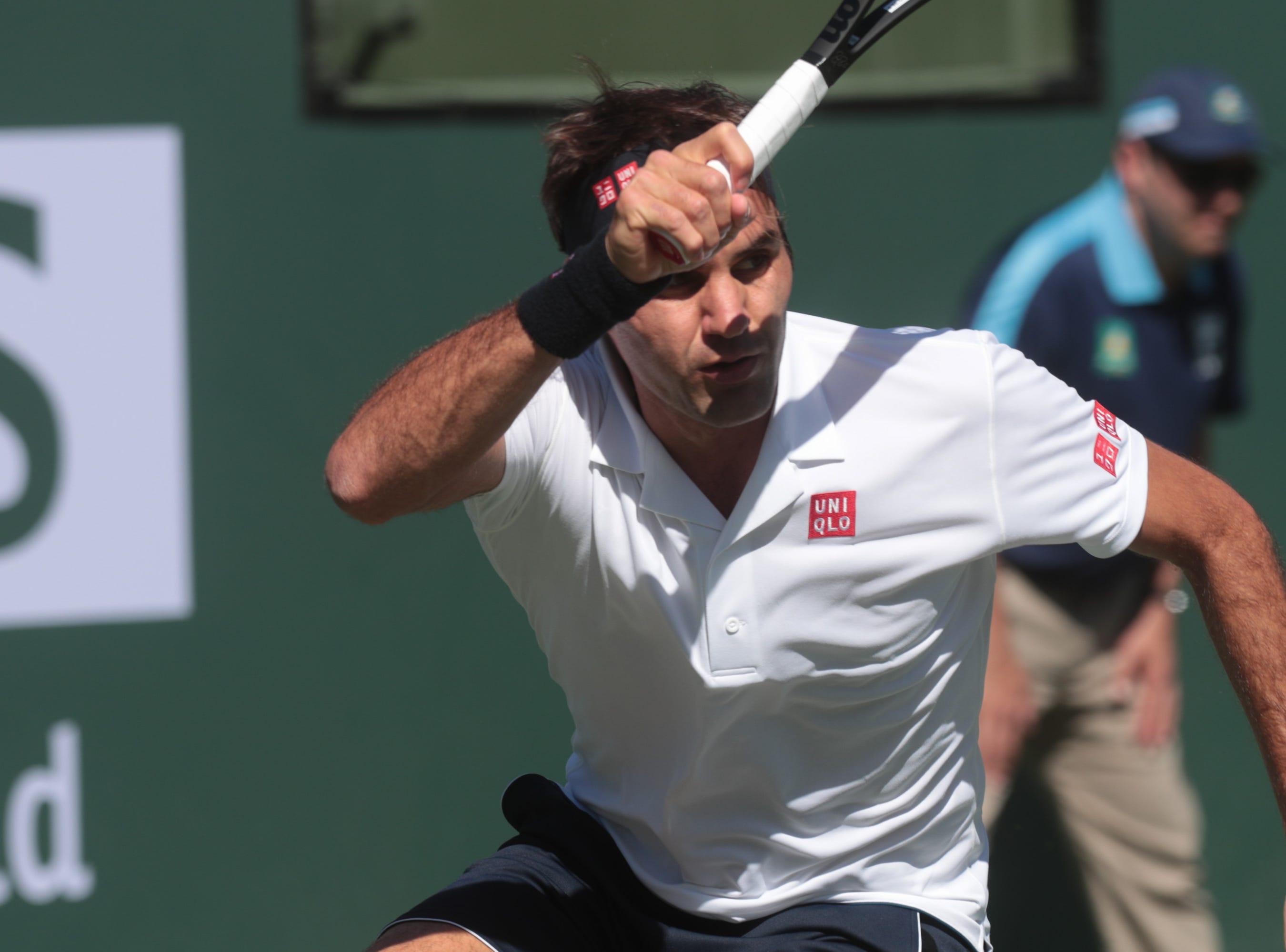Roger Federer returns to Kyle Edmund at the BNP Paribas Open in Indian Wells, Calif., March 13, 2019.