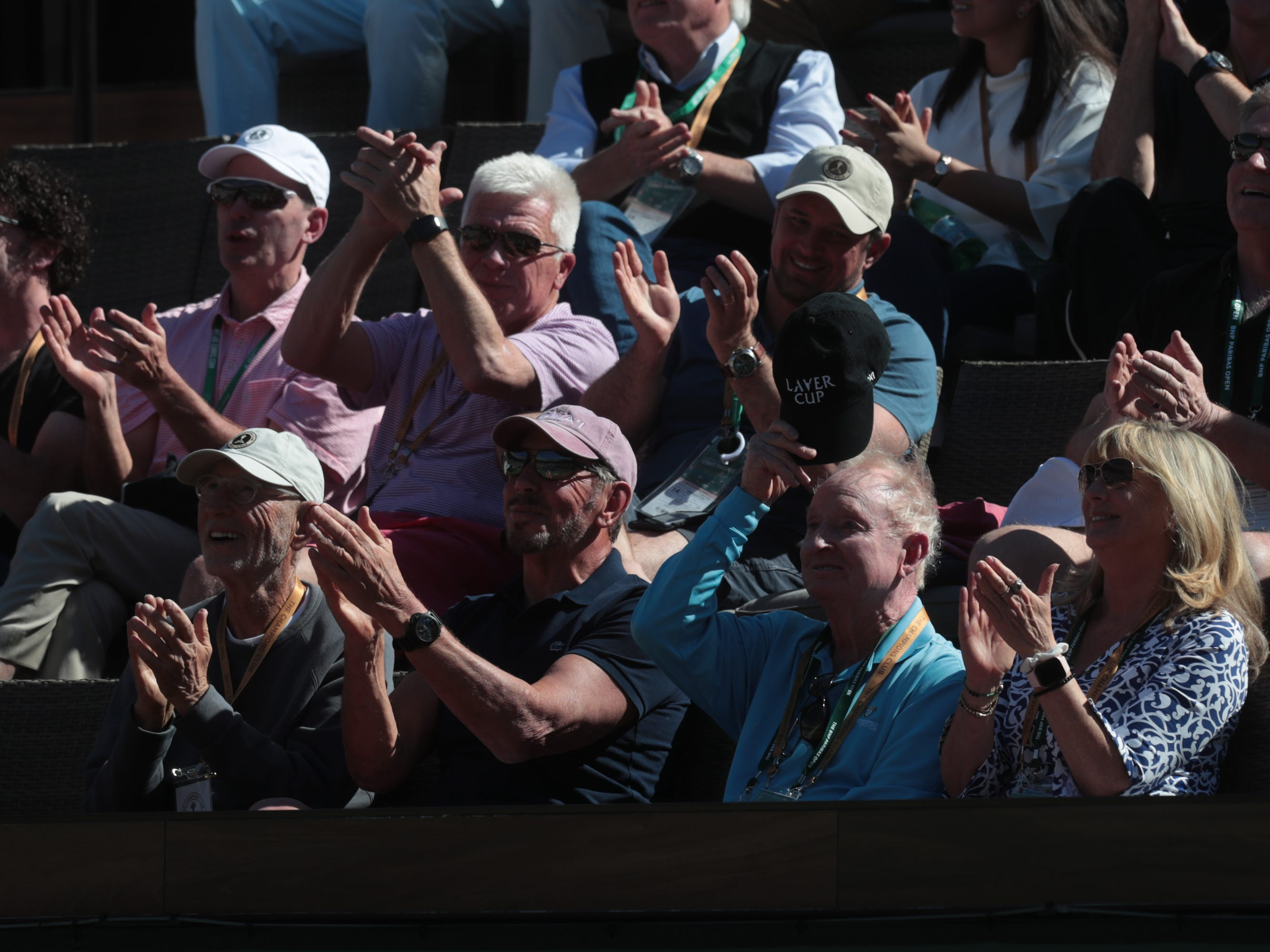 Rod Laver tips his hat to fans at the BNP Paribas Open in Indian Wells, Calif., March 13, 2019.