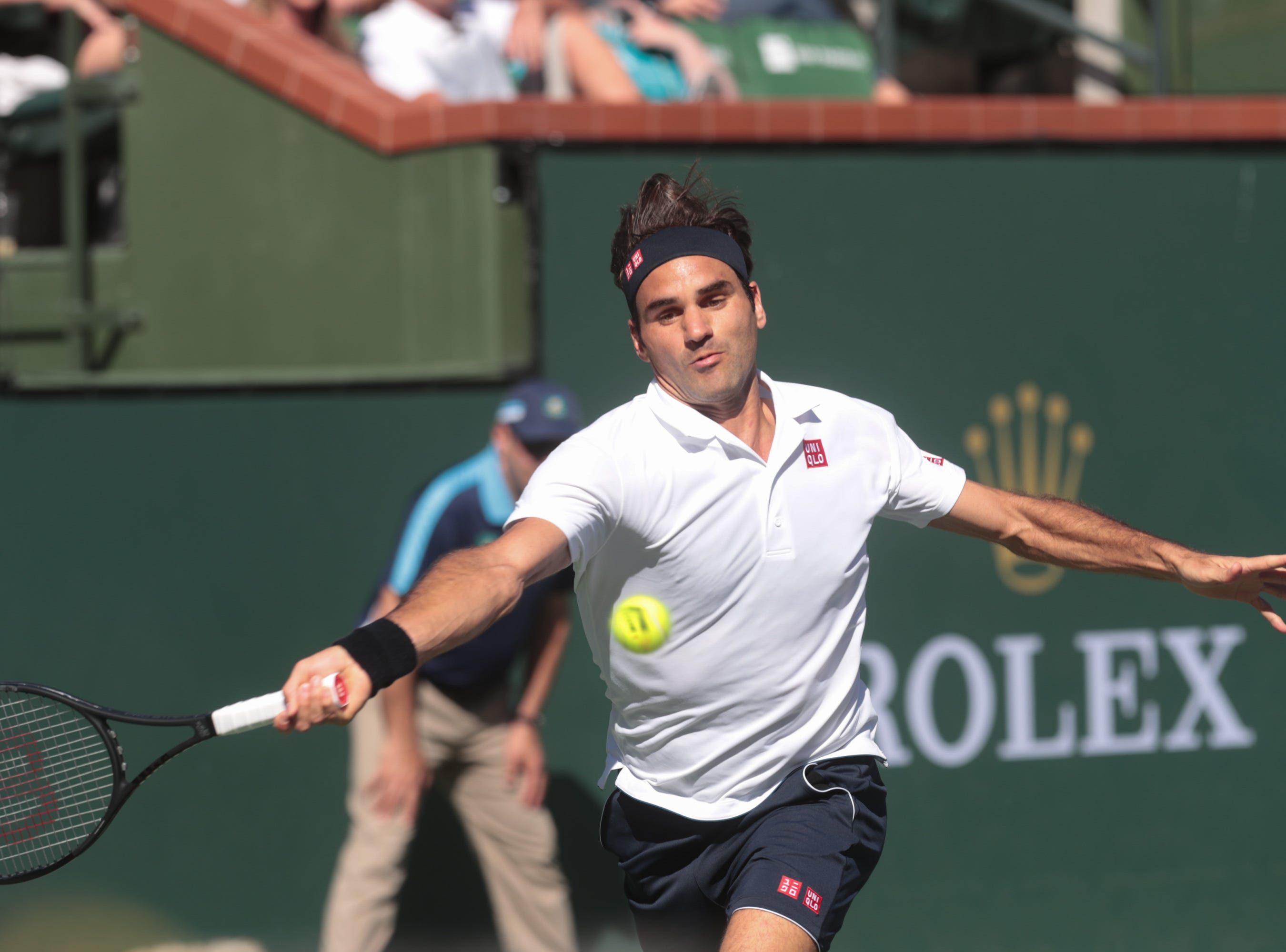 Roger Federer reaches for a shot from Kyle Edmund at the BNP Paribas Open in Indian Wells, Calif., March 13, 2019.