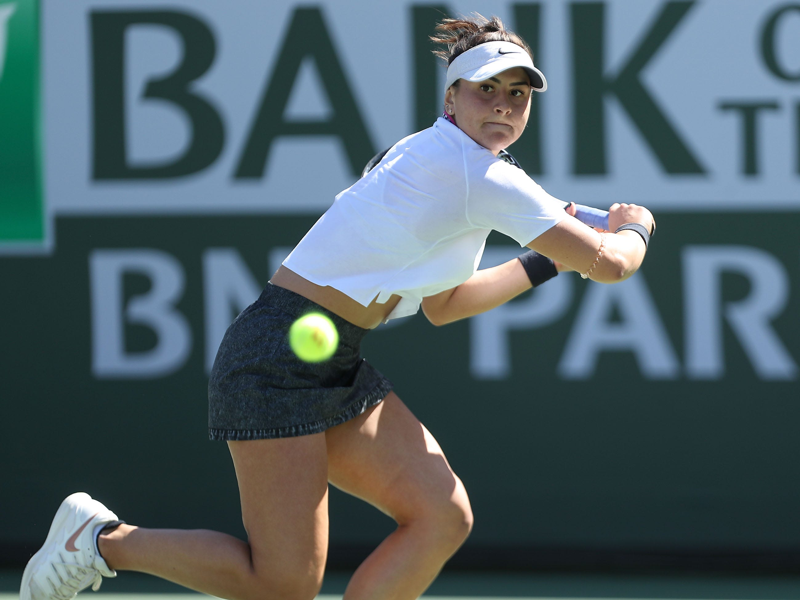 Bianca Andreescu reaches for a shot during her win over Garbine Muguruza at the BNP Paribas Open in Indian Wells, March 13, 2019.