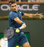 Roger Federer returns to Stan Wawrinka on Stadium One at the 2019 BNP Paribas Open at Indian Wells Tennis Garden on March 12, 2019. Federer won the match 6-3, 6-4.