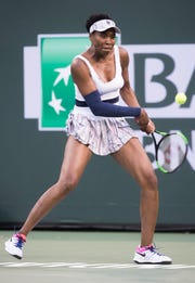 Venus Williams returns a shot to Mona Barthel on Stadium One at the 2019 BNP Paribas Open at Indian Wells Tennis Garden on March 12, 2019.
