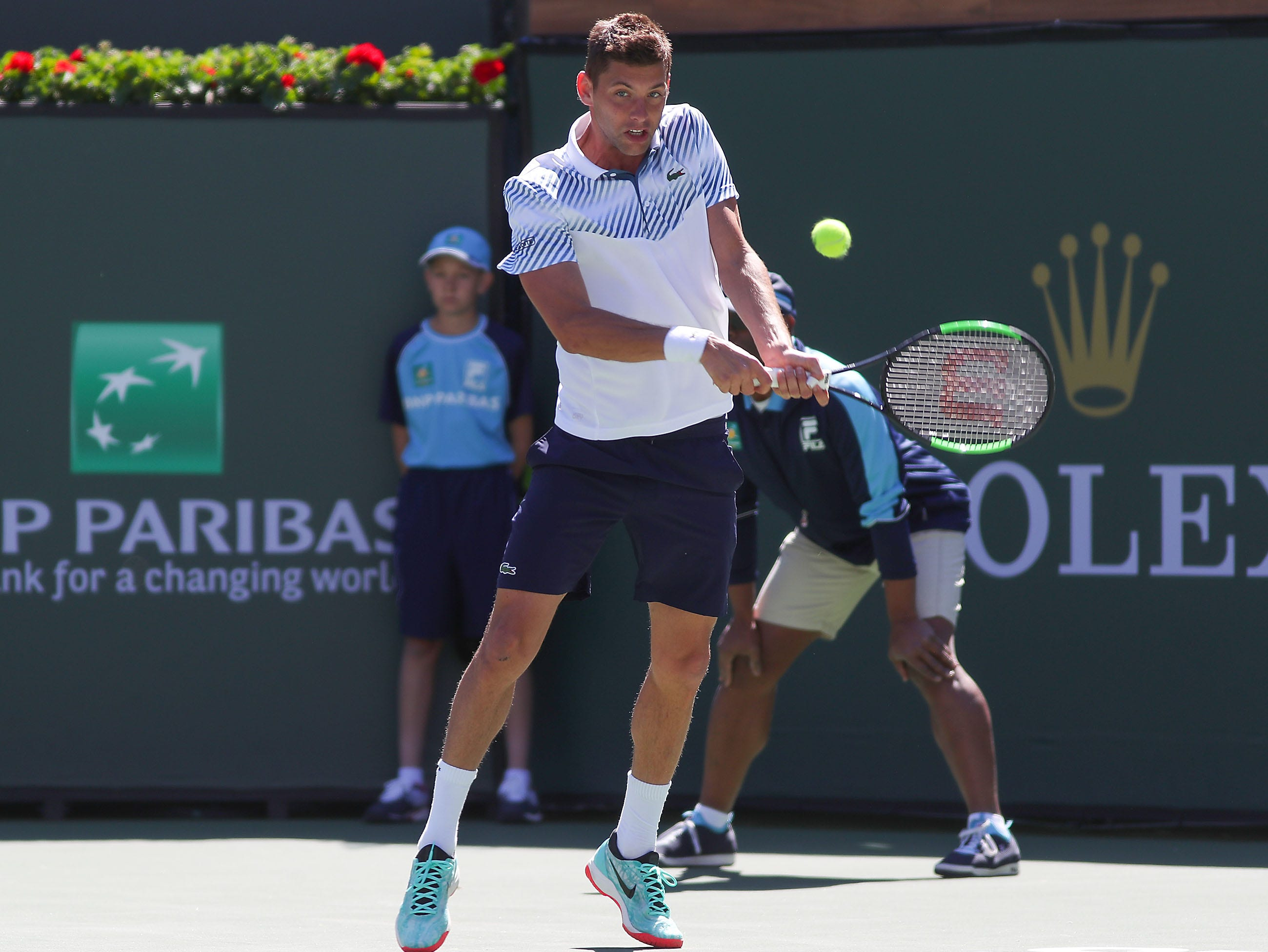 Filip Krajinovic hits a shot during his loss to Rafael Nadal at the BNP Paribas Open in Indian Wells, March 13, 2019.