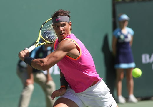 Rafael Nadal winds up to hit during his win over Filip Krajinovic during the BNP Paribas Open in Indian Wells, March 13, 2019.
