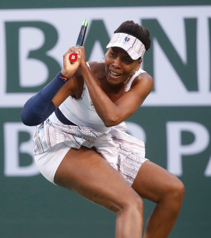 Venus Williams returns a backhand to Mona Barthel  on Stadium One at the 2019 BNP Paribas Open at Indian Wells Tennis Garden on March 12, 2019. Williams won the match 6-4, 6-4.