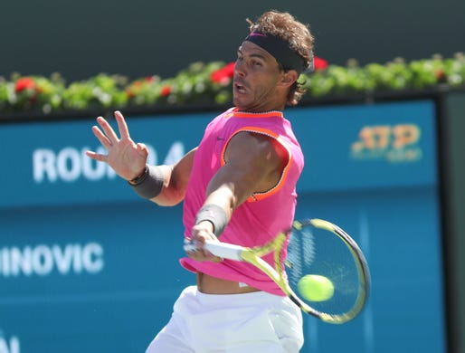Rafael Nadal hits a forehand during his win over Filip Krajinovic during the BNP Paribas Open in Indian Wells, March 13, 2019.