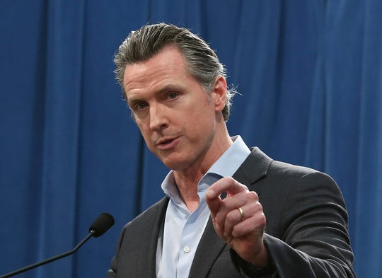 In this Monday Feb. 11, 2019 file photo Calif. Gov. Gavin Newsom answers questions at a Capitol news conference, in Sacramento, Calif. Newsom is expected to sign a moratorium on the death penalty in California Wednesday, March 13, 2019. (AP Photo/Rich Pedroncelli, File)