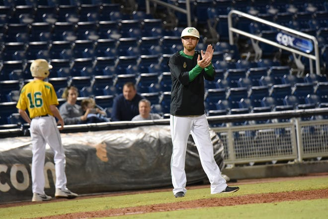 Pensacola Catholic baseball coach Seth Currie encourages his players in win against Gulf Breeze at Blue Wahoos Stadium on Tuesday, March 12, 2019.