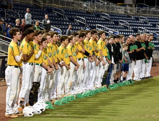 Pensacola Catholic baseball team lines up for National Anthem prior to a game against Gulf Breeze at Blue Wahoos Stadium on Tuesday, March 12, 2019.