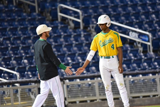 Pensacola Catholic baseball coach Seth Currie talks with shortstop T.J. McCants in win against Gulf Breeze at Blue Wahoos Stadium on Tuesday, March 12, 2019.