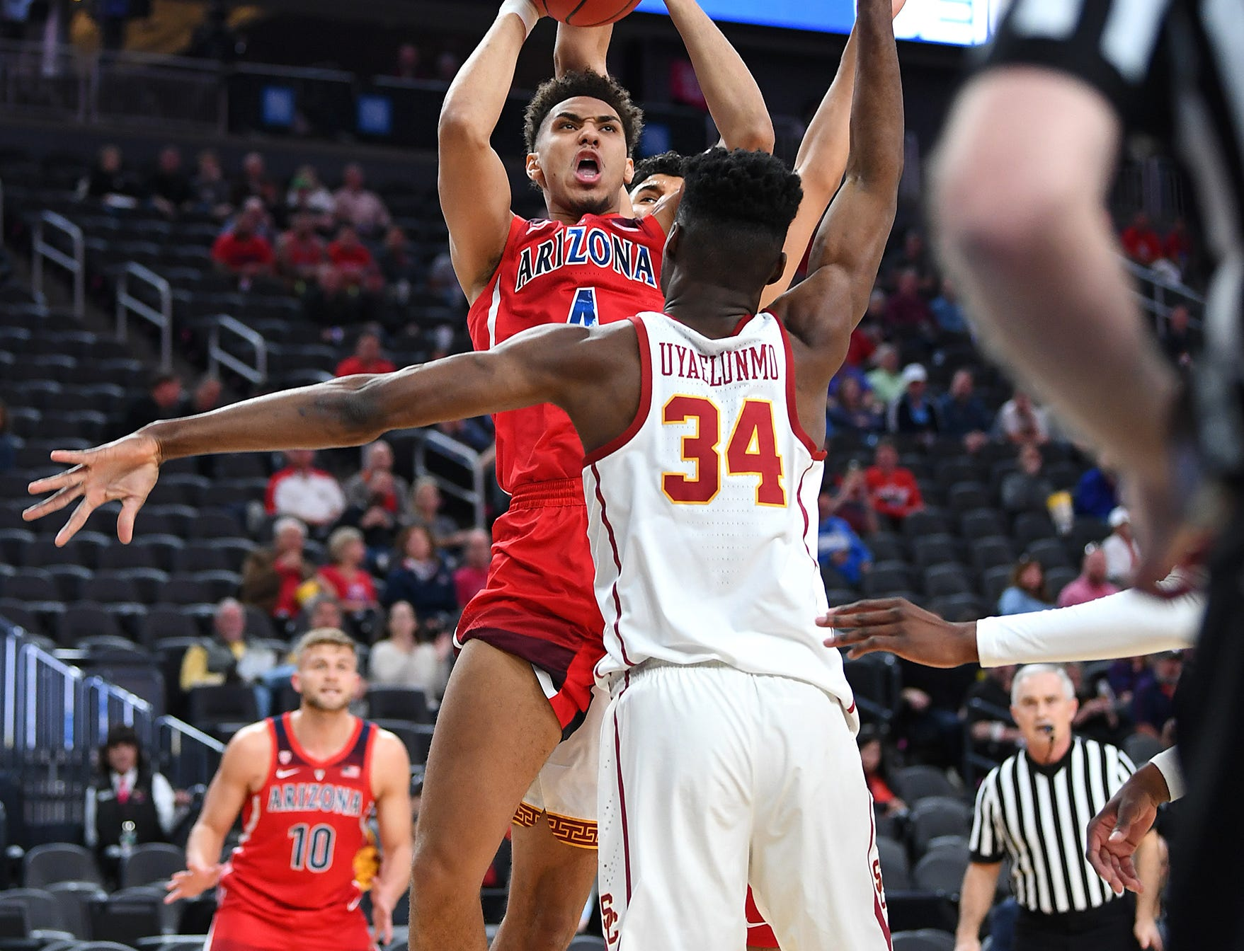 Mar 13, 2019; Las Vegas, NV, United States; Arizona Wildcats center Chase Jeter (4) shoots against USC Trojans forward Victor Uyaelunmo (34) during the first half of a Pac-12 conference tournament game at T-Mobile Arena. Mandatory Credit: Stephen R. Sylvanie-USA TODAY Sports