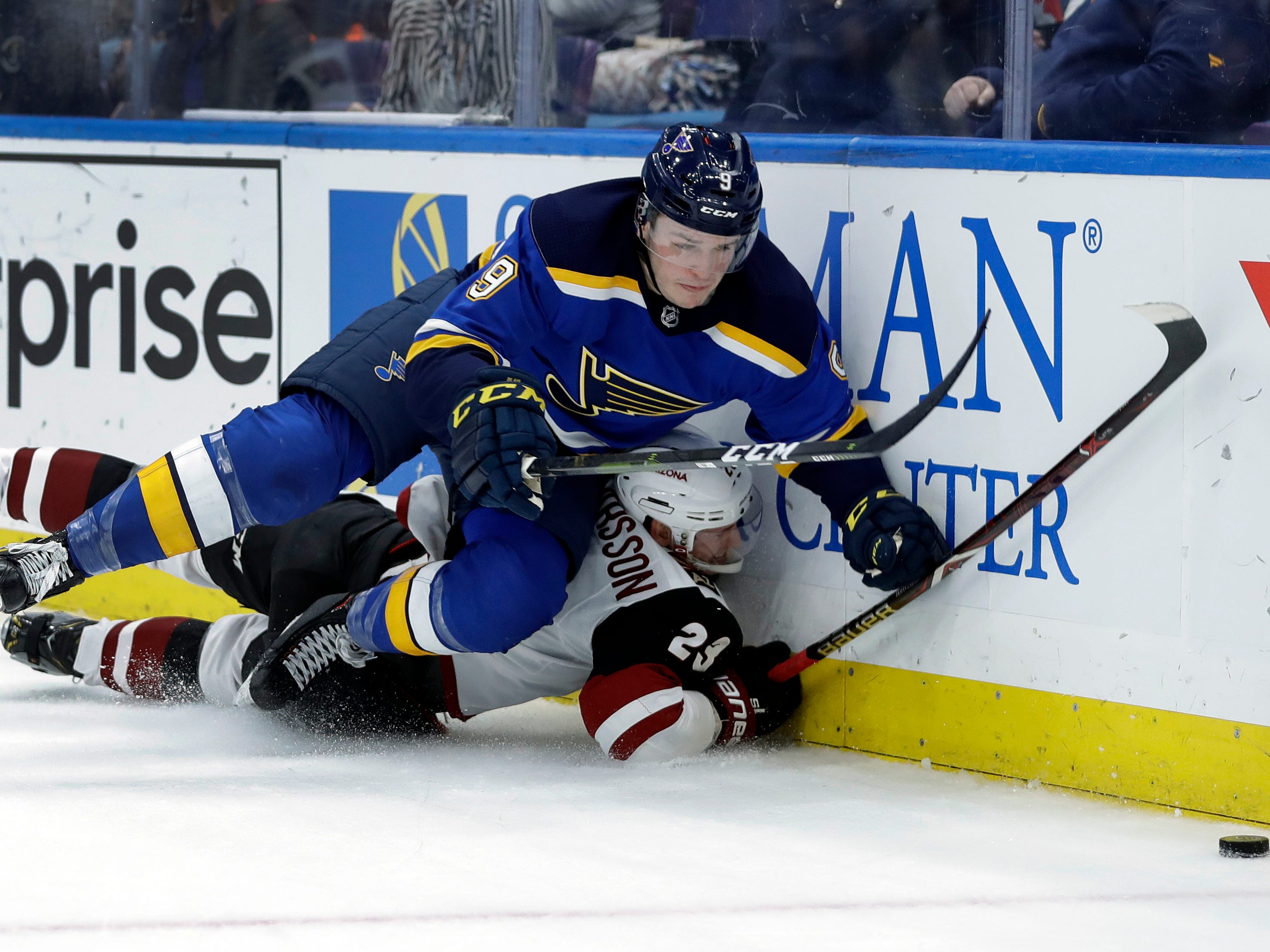 St. Louis Blues' Sammy Blais, top, and Arizona Coyotes' Oliver Ekman-Larsson, of Sweden, slam into the boards as they chase a loose puck during the second period of an NHL hockey game, Tuesday, March 12, 2019, in St. Louis.
