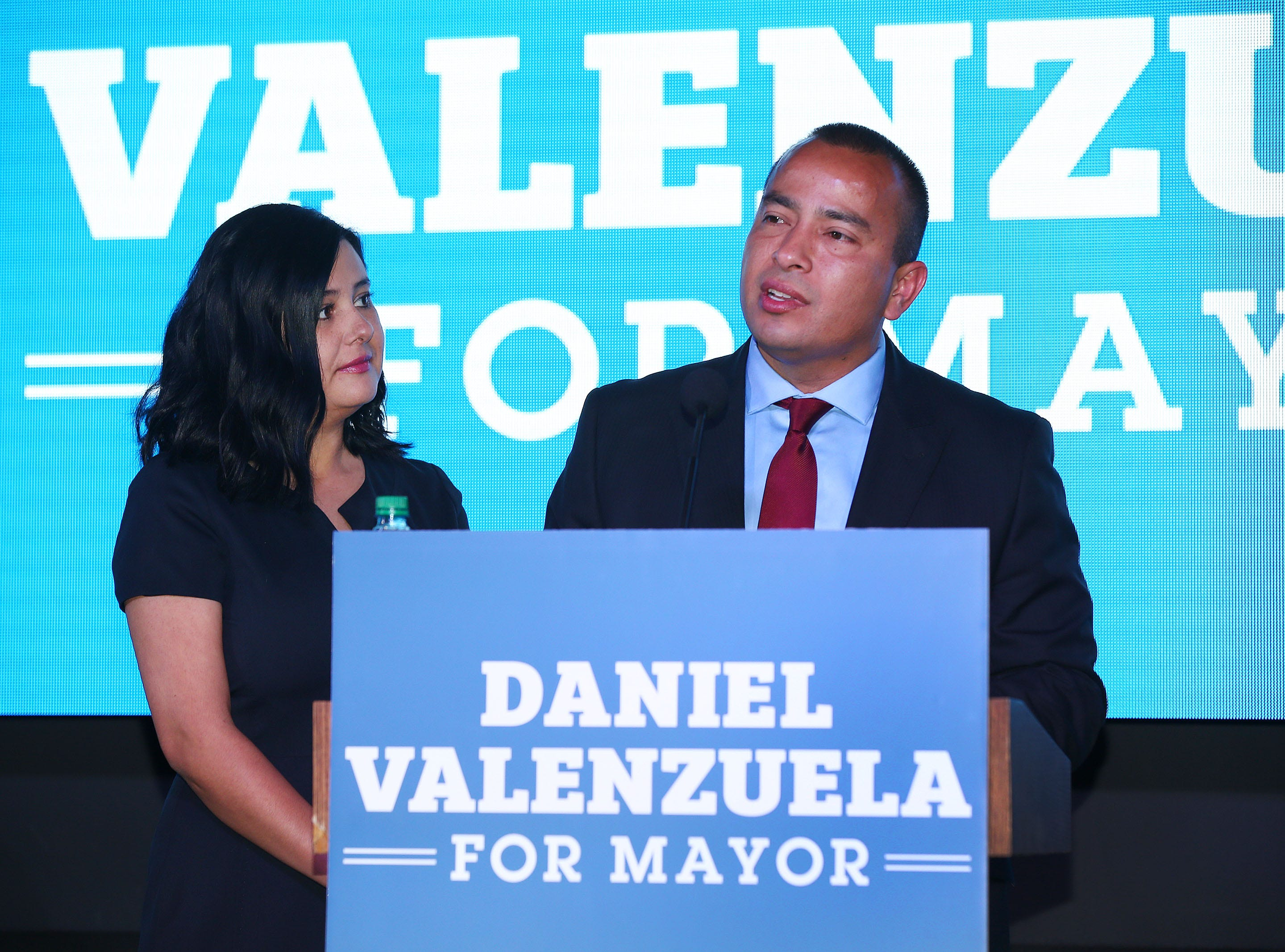 Daniel Valenzuela, candidate for Phoenix Mayor makes his concession speech with his wife Wendy at his side on March 12, 2019 in Phoenix.
